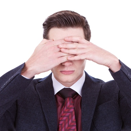 business man making the see no evil gesture over white  photo