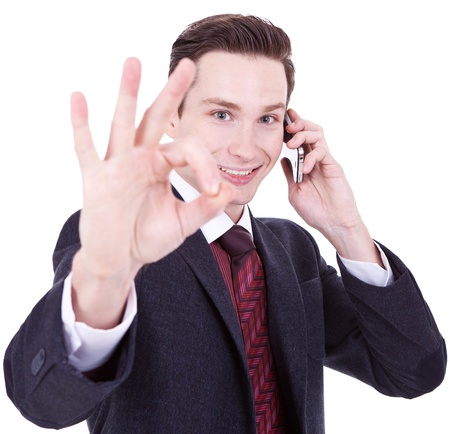 business man on the phone approving the good news over white background photo