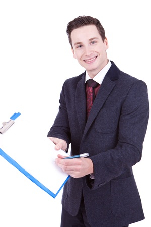 Happy smiling young business man showing blank clipboard, isolated on white background Stock Photo - 11890921