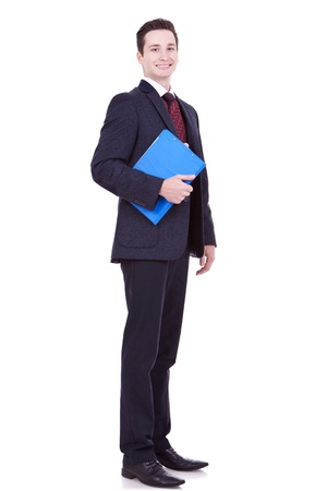 clipboard isolated: full body portrait of a young business man with a blue clipboard over white background