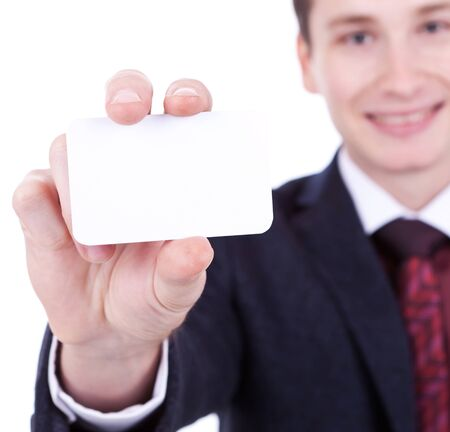 Close-up of business card in business mans hand on white background photo