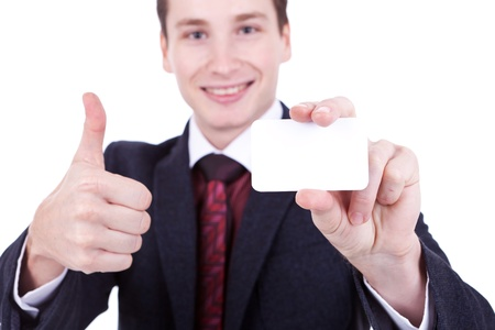 Business man showing a blank business card and giving the ok  photo