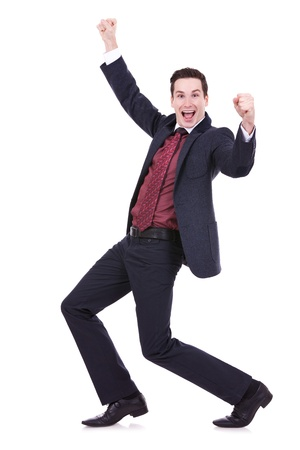 happy businessman: Very happy successful gesturing business man, isolated on white