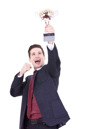 Happy business man holding a trophy aloft over white background photo