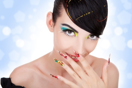 Beautiful young  woman giggles.  Fashion model with nice hair, make-up, manicure.  Stock Photo - 11971741