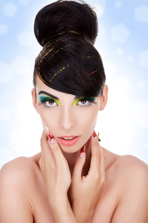 Clean image of a beautiful young woman . Beauty and health, cosmetics and make-up. Portrait of fashion woman model with bright yellow & green make-up, nice hairstyle  Stock Photo - 11971748