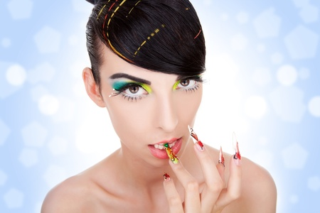 Cosmetics and nail products. Sexy beautiful female model with fashion make-up, sexy  lips,  makeup, bright nails with fancy hand made manicure Stock Photo - 11971736