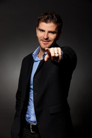 Handsome young business man points finger at you Stock Photo - 12076954