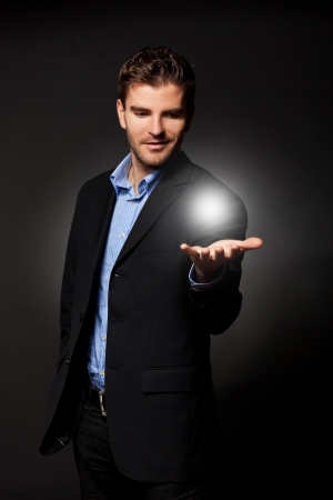 young casual business man holding the answer to all the problems Stock Photo - 12076949