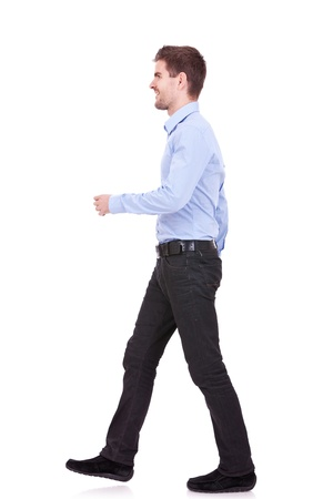 see side: side view of a fashion man walking forward over white
