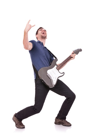 guitarist making a rock and roll gesture while screaming and playing  Stock Photo