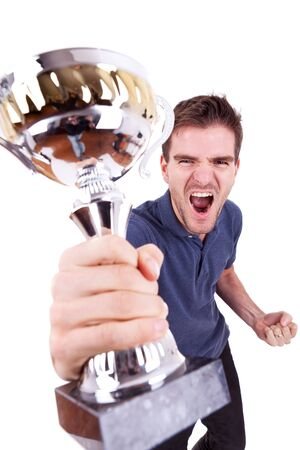 award trophy: portrait of an ecstatic young man winning the first place at a competition, on white background