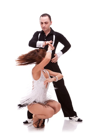 young couple in a difficult dance move. latino dance move performed by a young couple, on white background Stock Photo - 12581683