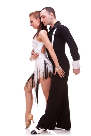 young couple of latino dancers posing on white background photo