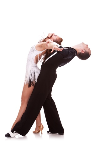 sensual dance of a latino couple. young couple dancing in a passionate latino pose on white background photo