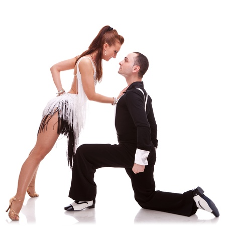 woman dancer leaning against her dance partner, in a sensual pose. passionate salsa dancing couple on white background photo