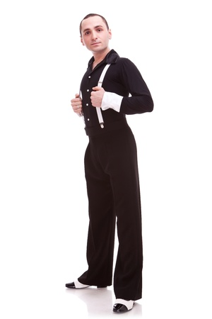 latino male dancer posing. isolated on white . full body of a man salsa dancer looking at the camera photo