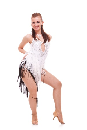 young latino woman dancer posing on white background. passionate woman in a salsa dance move photo