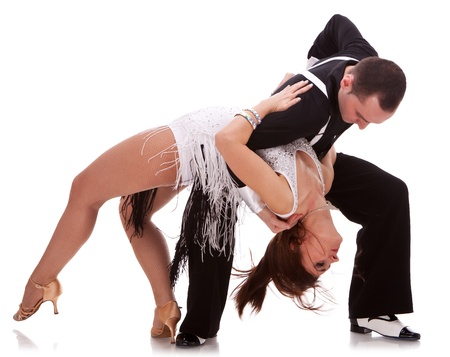 Young couple dances Caribbean Salsa. Passionate salsa dancing couple on white background photo