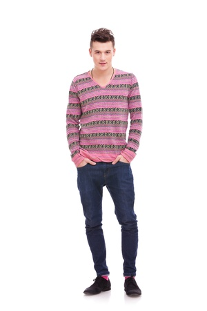 casual man standing isolated over a white background . full body picture of a young man with his hands in his pockets Stock Photo - 12581761