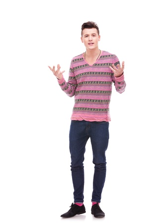 Young man talking and gesturing isolated on white background . casual man explaining something to the audience Stock Photo - 12581760