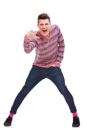 young casual  man doing a rock and roll symbol over white background  Stock Photo - 12581785