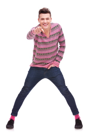 Portrait of a happy young man pointing at the camera over white background . full body picture of an excited young  casual man pointing to the camera Stock Photo - 12581773