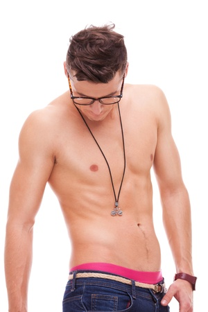 sexy muscular man wearing glasses and no shirt looking down on white background photo