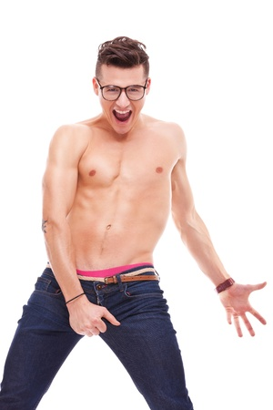 portrait picture of a sexy muscular man looking very excited on white background. screaming and laughing young fit shirtless man wearing glasses photo