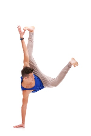 barefoot teens: Man Balancing on One Hand on white background. young dancer standing on one of his hands