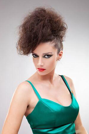 Beautiful brunette  woman with elegant green dress. Fashion photo  Stock Photo - 12581983