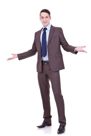 full length picture of an approachable young business man with open arms isolated on white background. businessman welcoming you photo