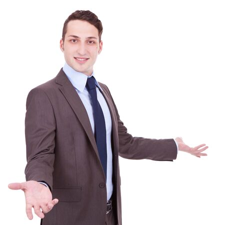 Approachable young business man with open arms isolated , Businessman welcoming on white background photo
