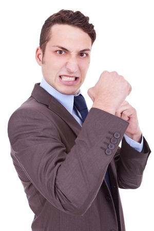 angriness: angry business man holding his fists into camera. Isolated on white background