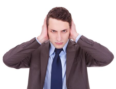 business man in the Hear no evil pose on white background. young businessman covering his ears with his hand photo