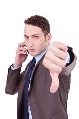 disapproving: Business man with bad news on his cell phone disapproving . negative answer