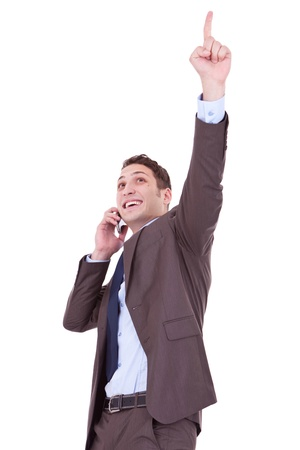bandwagon: happy business man with cellular phone winning over white background