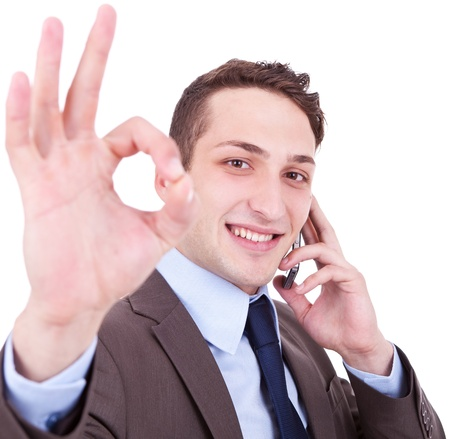 business man on the phone approving the good news on white background Stock Photo - 12581882