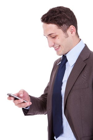 Handsome happy business man reading an SMS on cellphone against white Stock Photo - 12581958