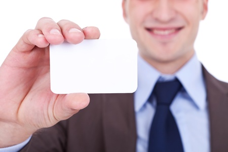 closeup picture of a business man holding a blank card in his hand on white background photo