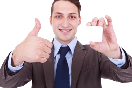 Business man showing a blank business card and giving the ok . this card is ok! photo