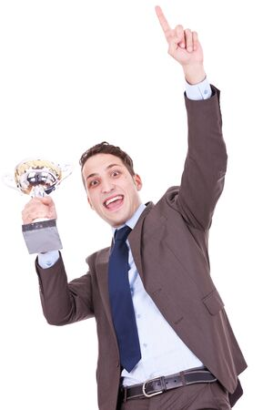 aloft: excited young business man holding a trophy aloft over white background. we have a winner! Stock Photo