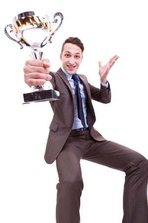 picture of an excited young business man winning a nice trophy on white background . excited businessman holding a gold and silver trophy cup photo