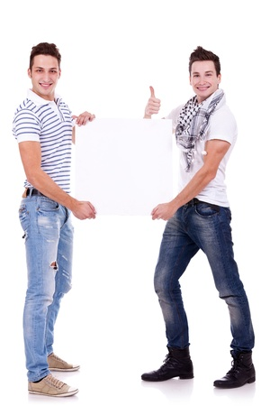 two young men holding a blank board on white background  photo