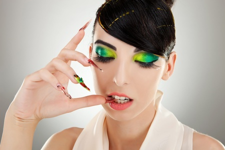 Cosmetics and nail products. Sexy beautiful female model with fashion make-up, sexy lips, makeup, bright nails with fancy hand made manicure  photo