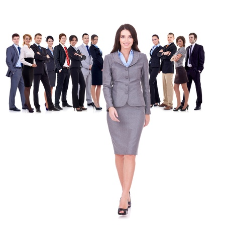 businessteamwork: successful business team with a business woman walking forward leading it - be different concept - isolated over a white background  Stock Photo