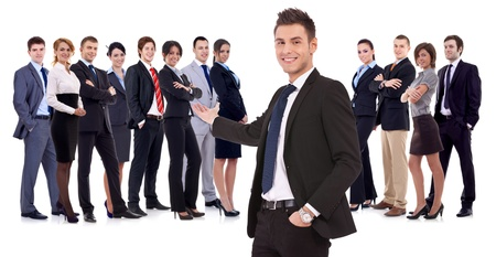 team leader: Successful happy business team being presented by a young leader, on white background  young business manwelcoming you to his business team Stock Photo