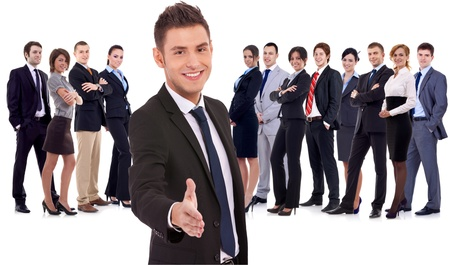 welcome people: Isolated successful business team, focus on man with handshake gesture  young business man welcoming to the team