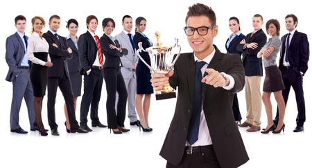 businessteam: winning business team with  leader holding a big trophy cup and pointing to you, on white background