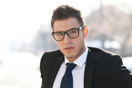 Head shot of executive wearing glasses - outdoor picture photo